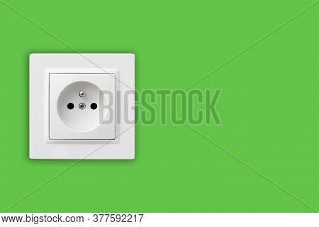 Brand New Electrical Socket Isolated On Green Wall. Renovated Studio Apartment Power Supply Backgrou
