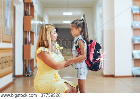 Mom Accompanies Daughter In The School Corridor.