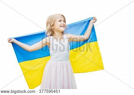 Child Carries Fluttering Blue And Yellow Flag Of Ukraine Isolated On White. Ukraine's Independence D