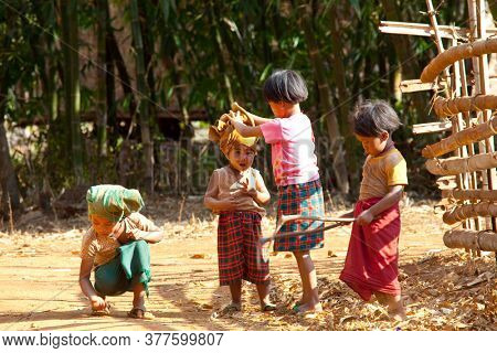 INLE LAKE, MYANMAR - FEBRUARY 2, 2011: Unidentified Pa-O tribe children in traditional colourful clothing in Inle lake area, Shan State, Myanmar (Burma).