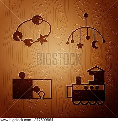 Set Toy Train, Rattle Baby Toy, Piece Of Puzzle And Baby Crib Hanging Toys On Wooden Background. Vec