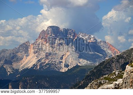 Rock Massif Of The Italian Dolomites On A Background Of Storm Clouds, Forests And Colorful Rocks