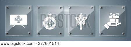 Set Gift Box In Hand, Christmas Star, Christmas Ball And Merry Christmas On Television. Square Glass