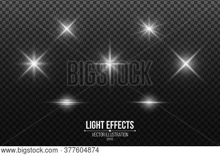 Set Of Shining Stars. Light Effects Isolated On A Black Transparent Background. White Glares And Fla