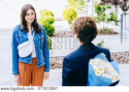 Man Hides Flower Bouquet Behind Back While Waits Girl Romantic Date. Guy Prepared Surprise For Girlf