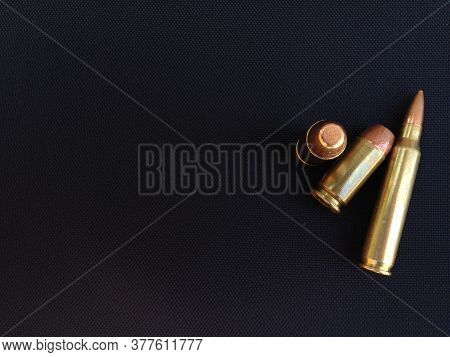 Bullets Rifle Handgun Pistol Firearm Closeup On Black Backgound Text Space Design Element Business C