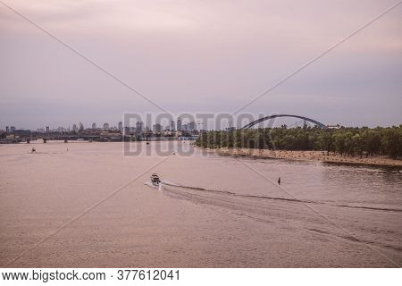 Kiev, Ukraine - June 23, 2020: Beautiful Panorama Of Kyiv City With Sunset Clouds And Reflection In