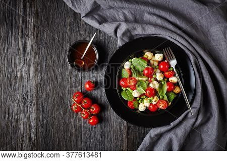 Colorful Appetizer: Caprese Salad With Baby Spinach, Cherry Tomatoes, Mini Mozzarella Balls, With Ba