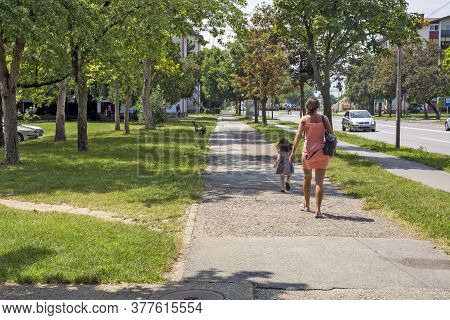 Mother And Daughter On The Street