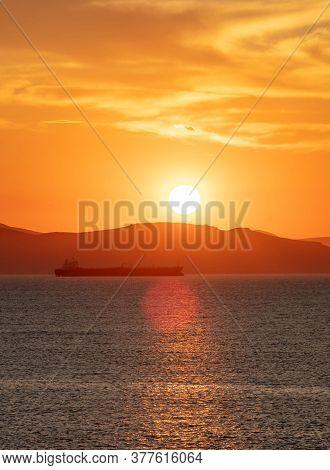 Sunset Orange Cloudscape Over Sea Water. Dramatic Magical Sunrise Seascape In Aegean Sea Greece. Twi
