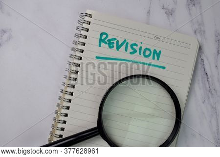 Revision Write On A Book Isolated Wooden Table.