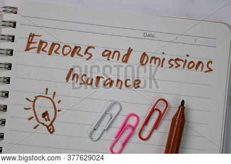 Errors And Ommisions Insurance Write On A Book Isolated Wooden Table.