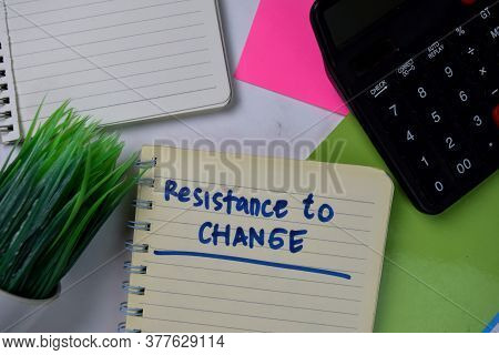 Resistance To Change Write On A Book Isolated Wooden Table.