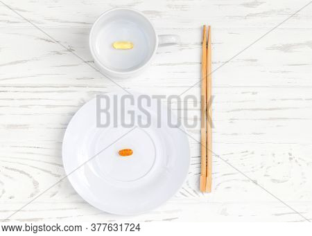 White Plate And Cup With Food Additives And Chopsticks