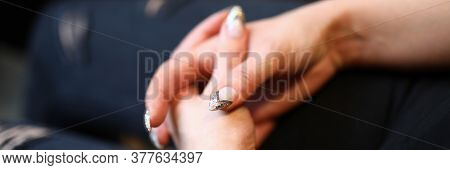 Close-up Of Female Folded Hands With Stylish French Manicure. Woman With Fitness Bracelet. Feminine