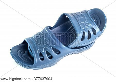 Pair Of Cheap Durable Blue Rubber Slippers One Inside Other Isolated On White Background.