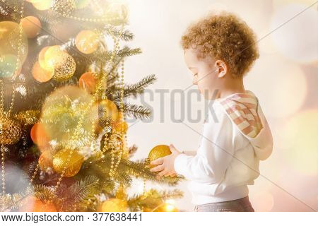 Boy Kid Near Christmas Tree, Magic New Year With Gifts And Good Mood