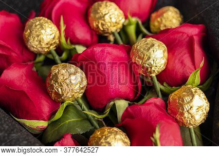 Bouquet Of Red Roses With Golden Chocolates