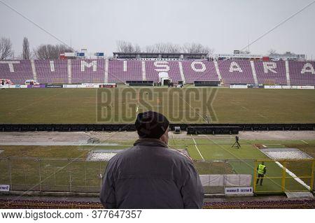 Timisoara, Romania - January 14, 2017: Man Observing The Empty Seats And Tiers Of Dan Paltinisanu St