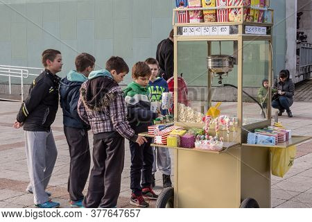 Valjevo, Serbia - February 13, 2016: Group Of Youngsters, Boys, Serbs, Waiting In Line In The Street
