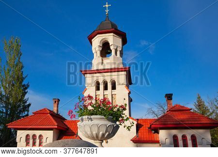 Steeple And Belfry With Cross On The Top