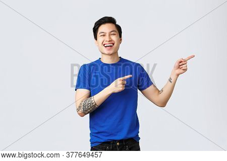 Different Emotions, People Lifestyle And Advertising Concept. Attractive Cheerful Queer Asian Man Ce
