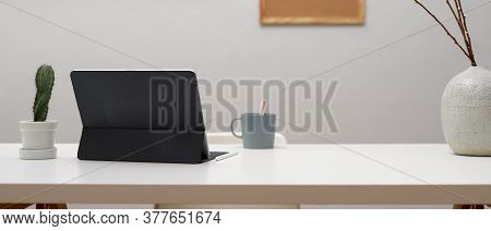 Home Office Desk With Digital Tablet, Mug, Decorations And Copy Space