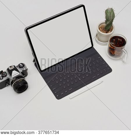 Blank Screen Tablet With Keyboard On White Table With Camera, Cactus Pot And Coffee Cup