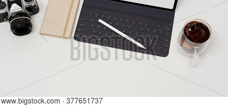 Simple Worktable With Digital Tablet, Coffee Cup, Diary Book, Camera And Copy Space