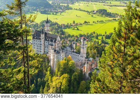 Neuschwanstein Castle in the Bavarian Alps of Germany from above.