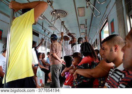 Salvador, Bahia / Brazil - April 15, 2015: Passengers Are Seen Inside A Train Car In The Suburb In T