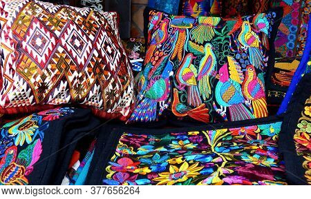 Cuenca, Ecuador - November 2, 2019: Close Up Of сolorful Embroidered Decorative Pillows And Textiles
