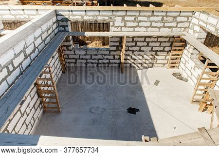 Building Site Of A House Under Construction. Unfinished House Walls Made From White Aerated Autoclav