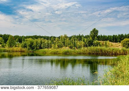 View On A Lake In Abandoned Sand Quarry And Dramatic Sky