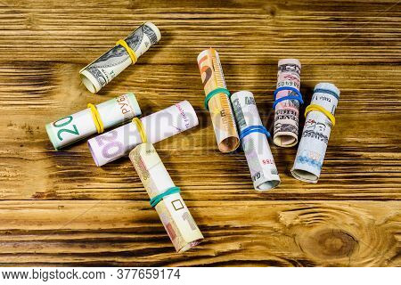 Many Rolled Up Banknotes. Euro, American Dollars, Ukrainian Hryvnias, Egyptian Pounds And Russian Ro
