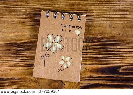 Closed Small Notepad On Rustic Wooden Table. Top View
