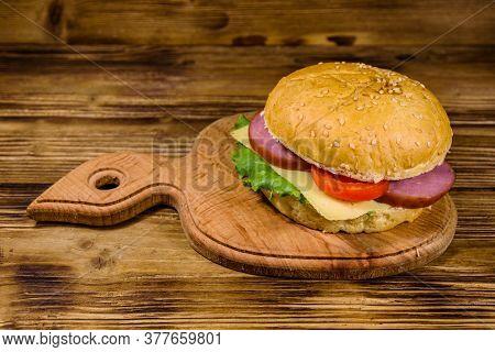 Fresh Hamburger On A Wooden Cutting Board