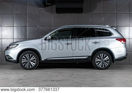 Novosibirsk/ Russia - May 25 2020: Silver Mitsubishi Outlander, Side View. Photography Of A Modern C