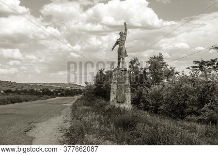 The Old Soviet Sculpture Worker And Collective Farm On Road Offers Entry Into A Dying Ukrainian Vill