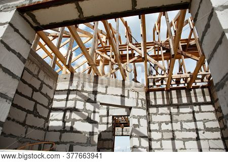Woods Elements And Components Of The Construction Of Roof. Ceiling Beams Of Natural Eco-friendly Mat