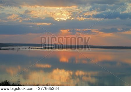 The Photo Was Taken In Ukraine Near The City Of Odessa. The Picture Shows A Sunset Over A Calm Estua