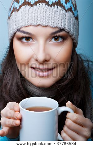 winter woman with ?up of hot tea