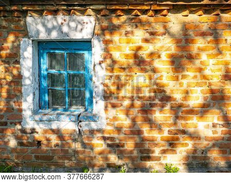 Old Window On A Background Of A Red Brick Wall. Country House. Place For Text. Template. Poster. Bui