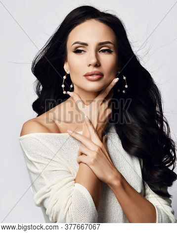 Young Wealthy Brunette Woman With Long Hair And Pouty Lips In One-shoulder Sweater And Stylish Earri