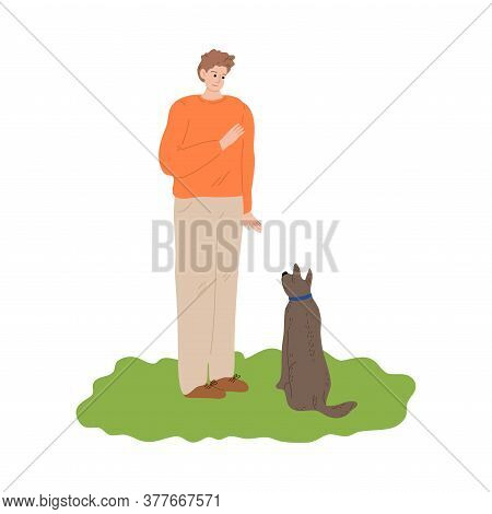 Boy Training His Dog By Showing Hand Command Outdoor During Walk