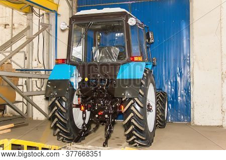 Tractors And Cab Harvesters. Agricultural Machinery At The Assembly Plant.