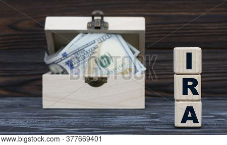 Ira (individual Retirement Account) - Acronym On Cubes Against The Background Of A Chest Of Money. B