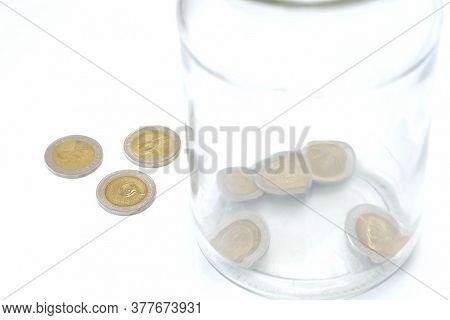 Glass Bottle And Coin On White Background. Concept For Finance Health Check Or Cost Of Business, Fin