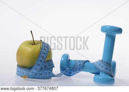 Health Regime And Fitness Symbols. Apple Fruit And Barbells