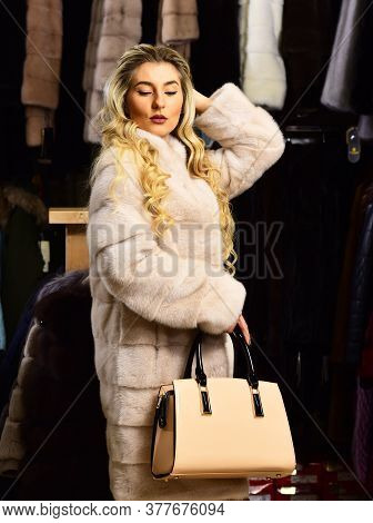 Woman With Mysterious Face In Long Beige Mink Fur Coat.